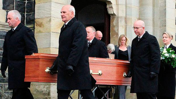 The coffin of Barney Fitzpatrick leaves St Mary's Star of the Sea