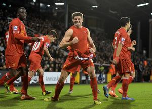 Liverpool's Steven Gerrard celebrates scoring his sides third goal of the game during the Barclays Premier League match at Craven Cottage, London