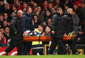 MANCHESTER, ENGLAND - OCTOBER 29: Robert Snodgrass of Norwich City leaves the field on a stretcher during the Capital One Cup fourth round match between Manchester United and Norwich City at Old Trafford on October 29, 2013 in Manchester, England.  (Photo by Clive Brunskill/Getty Images)