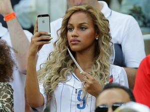 Belgian Fanny Neguesha, Mario Balotelli's girlfriend, attends at the group D World Cup soccer match between England and Italy at the Arena da Amazonia in Manaus, Brazil, Saturday, June 14, 2014. (AP Photo/Antonio Calanni)