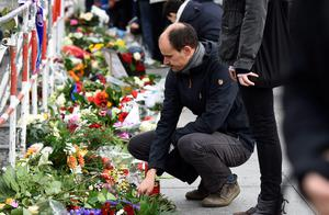 A man places flowers outside the French Embassy in Berlin on November 14, 2015, a day after deadly attacks in Paris. The string of coordinated attacks in and around Paris late November 13, 2015 left more than 120 people dead, in the worst such violence in France's history.  AFP PHOTO / TOBIAS SCHWARZTOBIAS SCHWARZ/AFP/Getty Images