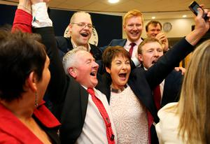 Richie McPhillips of the SDLP (second left) celebrates being elected in the constituency of Fermanagh & South Tyrone as counting continues at the Omagh count centre in the Northern Ireland Assembly Elections.Brian Lawless/PA Wire