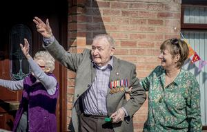 RAF Veteran Billy Reid celebrated his 100th birthday with piper Mark Smyth in the front garden of his Lisburn home in isolation amid the spread of coronavirus on Thursday, March 26th 2020 (Photo by Kevin Scott for Belfast Telegraph)