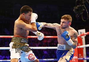 Carl Frampton (right) against Chris Avalos in February 2015