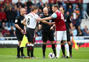 LONDON, ENGLAND - APRIL 06:  Opposing captains Steven Gerrard of Liverpool and Kevin Nolan of West Ham shake hands prior to kickoff during the Barclays Premier League match between West Ham United and Liverpool at Boleyn Ground on April 6, 2014 in London, England.  (Photo by Julian Finney/Getty Images)