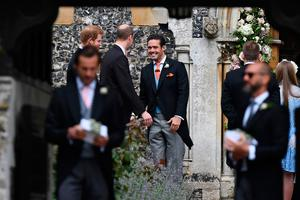 Spencer Matthews (C), brother of the groom, greets Britain's Prince William, Duke of Cambridge, and Britain's Prince Harry (L) outside the church ahead of the wedding of Pippa Middleton and James Matthews at St Mark's Church in Englefield, west of London, on May 20, 2017. Pippa Middleton hit the headlines with a figure-hugging outfit at her sister Kate's wedding to Prince William but now the world-famous bridesmaid is becoming a bride herself. Once again, all eyes will be on her dress as the 33-year-old marries financier James Matthews on Saturday at a lavish society wedding where William and Kate's children will play starring roles. / AFP PHOTO / POOL / Justin TALLISJUSTIN TALLIS/AFP/Getty Images