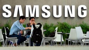 People sit in front the logo of South Korean electronics giant Samsung ahead of the opening of the 55th IFA (Internationale Funkausstellung), on September 2, 2015 in Berlin. IFA, one of the world's biggest consumer electronics shows, opens for the media before the public is invited from September 4 to 9. AFP PHOTO / JOHN MACDOUGALLJOHN MACDOUGALL/AFP/Getty Images