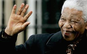 LONDON - NOVEMBER 26: Former President of South Africa Nelson Mandela waves as he leaves Downing Street November 26, 2004 in London, England.   (Photo by Ian Waldie/Getty Images)     *** Local Caption *** Nelson Mandela