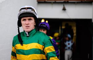 STRATFORD-UPON-AVON, ENGLAND - OCTOBER 31:  Tony McCoy makes his way to the parade ring at Stratford-Upon-Avon racecourse on October 31, 2013 in Stratford-Upon-Avon, England. (Photo by Alan Crowhurst/Getty Images)