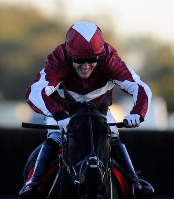 SUNBURY, ENGLAND - NOVEMBER 04:  Tony McCoy riding Foundation Man clear the last to win The Weatherbys Bank Foreign Exchange Handicap Steeple Chase at Kempton Park racecourse on November 04, 2013 in Sunbury, England. (Photo by Alan Crowhurst/Getty Images)