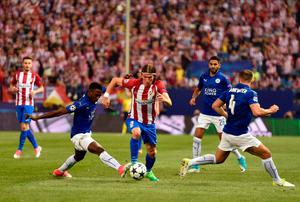 Leicester City's Nigerian midfielder Wilfred Ndidi (L) vies with Atletico Madrid's Brazilian defender Filipe Luis (C) during the UEFA Champions League quarter final first leg football match Club Atletico de Madrid vs Leicester City at the Vicente Calderon stadium in Madrid on April 12, 2017. / AFP PHOTO / GERARD JULIENGERARD JULIEN/AFP/Getty Images