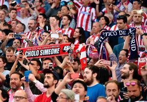 Atletico Madrid fans cheer their team before the UEFA Champions League quarter final first leg football match Club Atletico de Madrid vs Leicester City at the Vicente Calderon stadium in Madrid on April 12, 2017. / AFP PHOTO / GERARD JULIENGERARD JULIEN/AFP/Getty Images