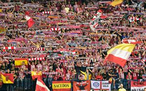 Atletico fans hold their svarves during the UEFA Champions League quarter final first leg football match Club Atletico de Madrid vs Leicester City at the Vicente Calderon stadium in Madrid on April 12, 2017. / AFP PHOTO / GERARD JULIENGERARD JULIEN/AFP/Getty Images