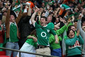 Republic of Ireland fans celebrate in the stands after Shane Long scores his side's first goal of the game during the International Friendly match at Wembley Stadium, London. PRESS ASSOCIATION Photo. Picture date: Wednesday May 29, 2013. See PA story SOCCER England. Photo credit should read: Nick Potts/PA Wire. RESTRICTIONS: Use subject to FA restrictions. Editorial use only. Commercial use only with prior written consent of the FA. No editing except cropping. Call +44 (0)1158 447447 or see www.paphotos.com/info/ for full restrictions and further information.