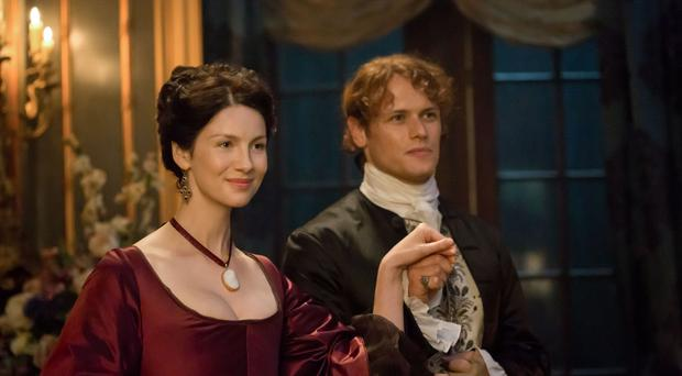 Outlander stars Caitriona Balfe as Claire Randall and Sam Heughan as Jamie Fraser (Starz/Sony Pictures Television/PA)