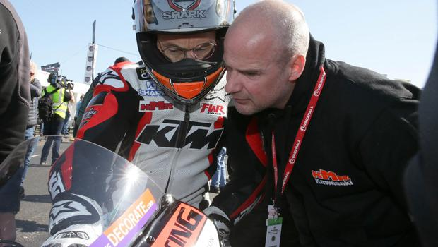 KMR Kawasaki's Jeremy McWilliams chats with team boss Ryan Farquhar on the grid during the second 2018 Vauxhall International North West 200 on Thursday.