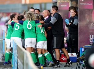 The Northern Ireland players rush to the dugout to celebrate the historic goal with the staff. It really was a team effort.