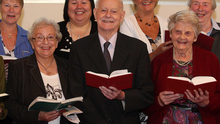 Former MP and leader of the Ulster Unionist Party Lord James Molyneaux pictured on his 90th birthday singing in choir at his church in RAF Aldegrove