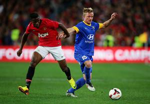 SYDNEY, AUSTRALIA - JULY 20:  Wilfried Zaha of Manchester United challeges Rhyan Grant of the All-Stars during the match between the A-League All-Stars and Manchester United at ANZ Stadium on July 20, 2013 in Sydney, Australia.  (Photo by Matt King/Getty Images)