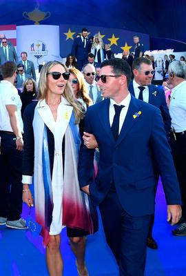PARIS, FRANCE - SEPTEMBER 27:  Rory McIlroy of Europe and wife Erica McIlroy depart the opening ceremony for the 2018 Ryder Cup at Le Golf National on September 27, 2018 in Paris, France.  (Photo by Ross Kinnaird/Getty Images)