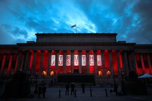 LIVERPOOL, ENGLAND - APRIL 26:  A banner reading Truth and Justice is hung from Liverpool's Saint George's Hall and illuminated in red after today's Hillsborough inquest verdict on April 26, 2016 in Liverpool, England. The fresh inquests into the 1989 Hillsborough disaster, in which 96 football supporters were crushed to death, concluded today on April 26, 2016 with a verdict of unlawful killing, after the initial verdicts were quashed. Relatives of Liverpool supporters who died in Britain's worst sporting disaster gathered in the purpose-built court to hear the jury's verdict in Warrington after a 25 year fight to overturn the accidental death verdicts handed down at the initial 1991 inquiry.  (Photo by Christopher Furlong/Getty Images)