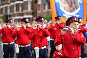 The Orange Order parade through Ardoyne passed off peacefully in Belfast, Northern Ireland. Picture By: Arthur Allison/Pacemaker Press.