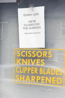 A sign in a barbers shop which is still unable to open in Buncranna. Credit: Martin McKeown