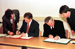 "10th anniversary of The Good Friday Agreement...File photo dated 10/04/98 of former British Prime Minister, Tony Blair (Left) and Irish Taoiseach Bertie Ahern signing The Northern Ireland Peace Agreement 10 years ago. PRESS ASSOCIATION photo. Issue date: Thursday April 10, 2008. The Good Friday Agreement set Northern Ireland on a path to reconciliation and peace 10 years ago, Senator Edward Kennedy said today. As politicians who negotiated the accord, including Irish Taoiseach Bertie Ahern, gathered in Belfast to mark its 10th anniversary, the veteran Massachusetts senator paid tribute in Washington to the people of Northern Ireland and their leaders. ""The people of Northern Ireland and the courageous leaders of the political parties in Northern Ireland, Ireland, and Great Britain, all deserve special recognition on this day for their deep and unwavering commitment to peace. See PA Story ULSTER Agreement. Photo Credit should read: Dan Chung/PA Wire   ...A"