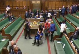 Labour MP Tulip Siddiq is wheeled through the chamber while MPs vote (House of Commons/PA)