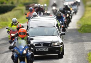 Dr Hinds' partner Janet and his colleague Dr Fred MacSorley lead the cortege joined by hundreds of bikers. Pic: Colm Lenaghan/Pacemaker