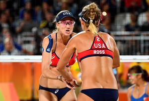USA's Kerri Walsh Jennings (L) and April Ross celebrate after winning a point during the women's beach volleyball qualifying match between the USA and China at the Beach Volley Arena in Rio de Janeiro late on August 8, 2016, for the Rio 2016 Olympic Games. / AFP PHOTO / Leon NEALLEON NEAL/AFP/Getty Images