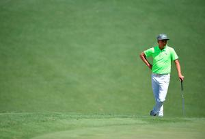 US golfer Rickie Fowler waits to play a shot during Round 1 of the 80th Masters Golf Tournament at the Augusta National Golf Club on April 7, 2016, in Augusta, Georgia.   / AFP PHOTO / Jim WatsonJIM WATSON/AFP/Getty Images