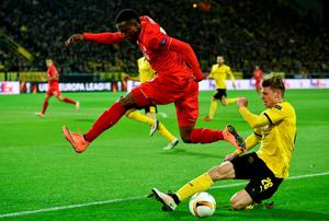 Divock Origi of Liverpool is tackled by Lukasz Piszczek of Borussia Dortmund during the UEFA Europa League quarter final first leg match between Borussia Dortmund and Liverpool at Signal Iduna Park on April 7, 2016 in Dortmund, Germany.  (Photo by Stuart Franklin/Bongarts/Getty Images)