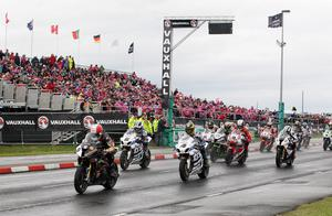 Michael Rutter (Bathams BMW) get the 'holeshot of the line at the start of  the Eventserv Superbike Race during  at the Vauxhall International 2014  North West 200.