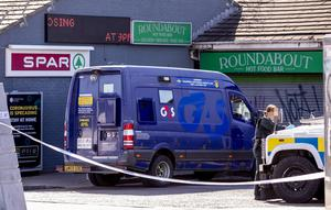 Police at the scene of a cash van robbery at a Spar shop on the Glen Road in west Belfast  on April 11th 2020 (Photo by Kevin Scott for Belfast Telegraph)