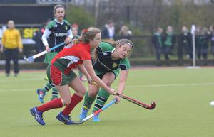 Mandatory Credit: Rowland White / PressEye Belfast Telegraph Schools' Cup Semi-Final Teams: Friends' School (red) v Sullivan Upper (green) Venue: Lisnagarvey Date: 11th February 2015 Caption: Shannon King, Friends and Zara Malseed, Sullivan