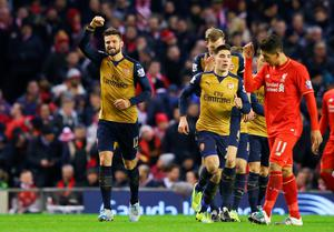 LIVERPOOL, ENGLAND - JANUARY 13:  Olivier Giroud (1st L) of Arsenal celebrates scoring his team's second goal  during the Barclays Premier League match between Liverpool and Arsenal at Anfield on January 13, 2016 in Liverpool, England.  (Photo by Alex Livesey/Getty Images)