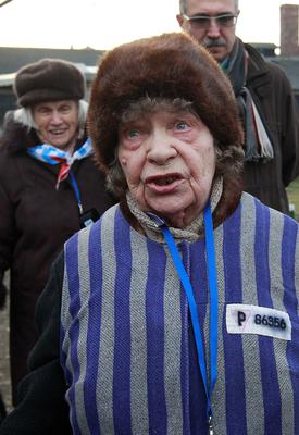 Holocaust survivor Jadwiga  Bogucka  arrives to attend ceremonies to  commemorate the people killed by the Nazis at the former Auschwitz Nazi death camp in Oswiecim, Poland, Wednesday, Jan. 27, 2016,  the International Holocaust Remembrance Day that marks  the liberation of the Auschwitz Nazi death camp on Jan. 27, 1945. (AP Photo/Czarek Sokolowski)