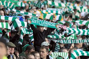 GLASGOW, UNITED KINGDOM - MAY 04: A young Celtic fan shows his support for Celtic caretaker manager Neil Lennon during the Clydesdale Bank Scottish Premier League match between Celtic and Rangers at Celtic Park, on May 4, 2010 in Glasgow, Scotland.  (Photo by David Cannon/Getty Images)