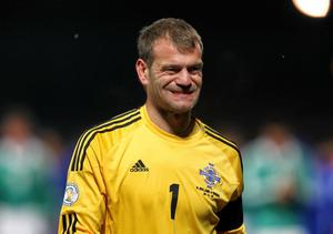 Northern Ireland's Roy Carroll is dejected after the team's defeat to Israel in Tuesday's World Cup Qualifier at Windsor Park, Belfast
