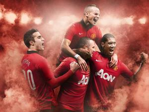 Tom Cleverley, Robin van Persie, Wayne Rooney and Chris Smalling wear the new Manchester United home kit NIKE