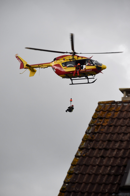 A rescuer is lifted down from a helicopter of the Securite Civile, France's civil defence agency, to reach stranded residents following floods on June 1, 2016 in Nemours, southeast of Paris. Torrential downpours have lashed parts of northern Europe in recent days, leaving four dead in Germany, breaching the banks of the Seine in Paris and flooding rural roads and villages. AFP/Getty Images