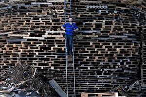 LARNE, NORTHERN IRELAND - JULY 10: 'Hurka' the chief architect and builder of the Craigyhill bonfire takes a break from stacking pallets to pose with his creation whilst balancing on a ladder on July 10, 2017 in Larne, Northern Ireland. (Photo by Charles McQuillan/Getty Images)