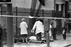 PACEMAKER PRESS INTL. BELFAST. Gerry Adams shooting in Belfast City Centre. Scene at Wellington Place where the three gunmen were captured one of which was injured. 14/3/84. 213/84/bw
