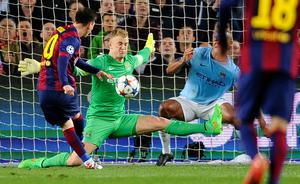 Manchester City's goalkeeper Joe Hart, center, and Manchester City's Vincent Kompany, right, save against Barcelona's Lionel Messi, left, during a Champions League round of 16 second leg, soccer match between FC Barcelona and Manchester City at Camp Nou stadium, in Barcelona, Spain, Wednesday, March 18, 2015. (AP Photo/Manu Fernandez)