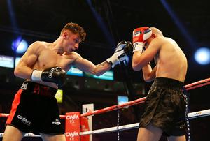 28th February 2015   ?William Cherry/Presseye  Josh Pritchard with Aron Szilagy during Saturday nights Super Featherweight contest at the Odyssey Arena.