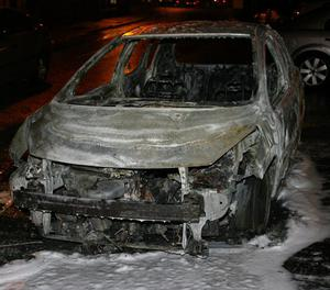 PACEMAKER BELFAST  08/03/2013  The shell of a torched car after rioting on the Carnmoney Road Glengormley.