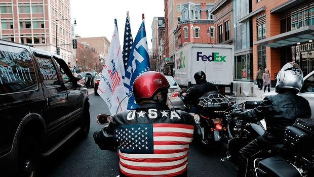 WASHINGTON, DC - JANUARY 19:  Donald Trump supporters drive through downtown on January 19, 2017 in Washington, DC. Washington and the entire nation are preparing for the transfer of the United States presidency as Trump is sworn in as the 45th president January 20.  (Photo by Spencer Platt/Getty Images)