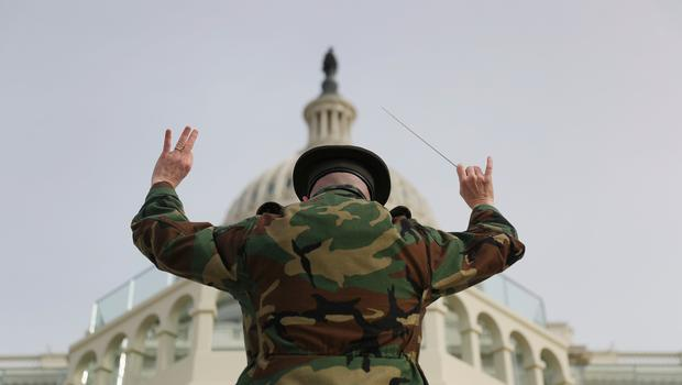 WASHINGTON, DC - JANUARY 19: Lt Col Jason Fettig of the Marine band rehearses on the West Front of the U.S. Capitol on January 19, 2017 in Washington, DC. Donald J. Trump will be sworn in tomorrow as the 45th president of the United States.  (Photo by Joe Raedle/Getty Images)