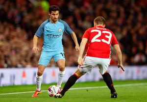 Jesus Navas of Manchester City (L) takes on Luke Shaw of Manchester United (R) during the EFL Cup fourth round match between Manchester United and Manchester City at Old Trafford on October 26, 2016 in Manchester, England.  (Photo by David Rogers/Getty Images)